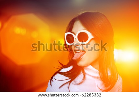 Fun portrait of young woman sticking her tongue out