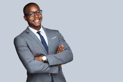 Fun smiling african american businessman in stylish modern suit isolated with copy space