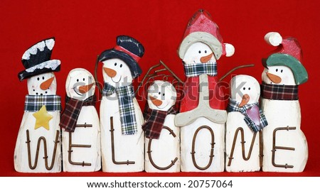 fun welcome sign with different snowmen