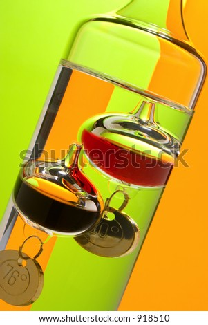 Fun with reflections and colors. Galileo thermometer with dramatic colors in background.