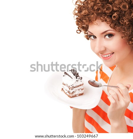 fun woman eating the cake on the white background