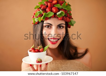 Fun woman with strawberry hat  and cup of strawberry tea