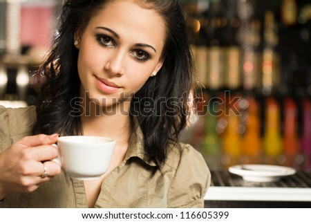 Fun young brunette beauty in coffee shop.