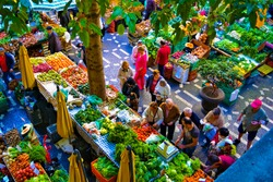 FUNCHAL, MADEIRA / PORTUGAL - FEBRUARY  2017: PEOPLE AT FUNCHAL FARM MARKET. VIEW FROM ABOVE.