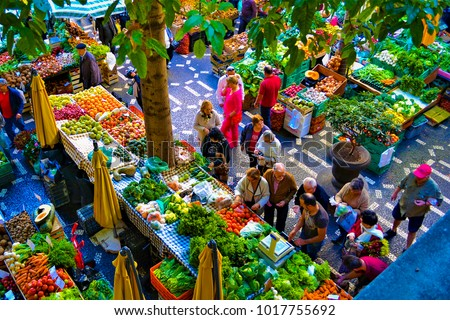 FUNCHAL, MADEIRA / PORTUGAL - FEBRUARY  2017: PEOPLE AT FUNCHAL FARM MARKET. VIEW FROM ABOVE. #1017755692