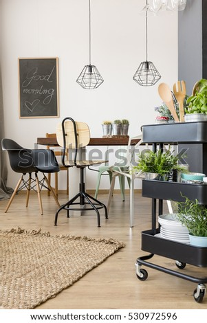 Functional apartment with dining table and rolling kitchen utility cart