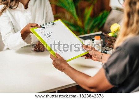 Functional medicine doctor giving personal health plan to the client Stock photo ©