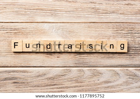fundraising word written on wood block. fundraising text on table, concept. #1177895752