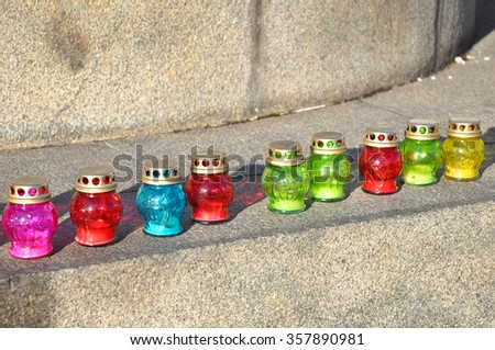 Funeral candles on the stone stairs