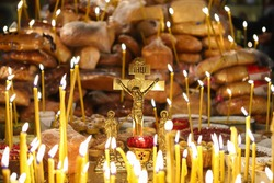 Funeral liturgy with prayer for the dead. Crucifixion, bread and candles in the Orthodox Church. The concept of Orthodoxy.