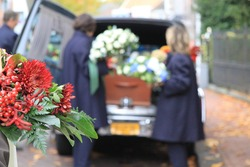 Funeral procession with flowers in car
