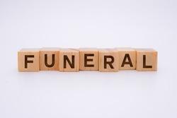 Funeral Word Written In Wooden Cube