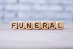 Funeral word written on wood block