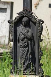 Funerary metal statue of the Virgin Mary in cemetery ,Gherla, Romania,2018