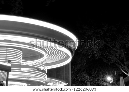funfair ride picture, long exposure lights with rotational effect, black and white