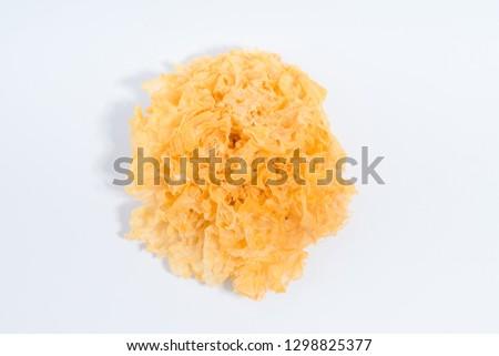 Fungus food - dried white fungus close-up. Edible dry mushroom for soups