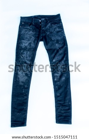 Fungus grows on jeans that have not been washed before and damp, white background.