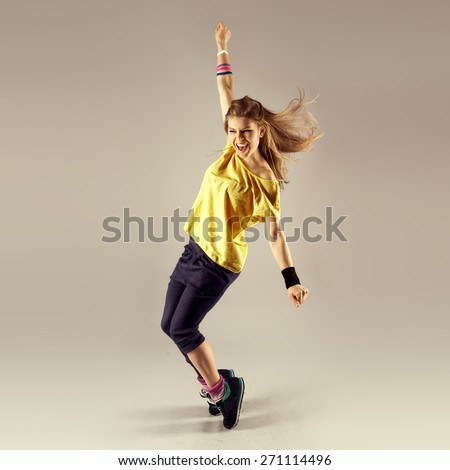Funk dance workout. Portrait of young sporty woman in motion. Zumba #271114496