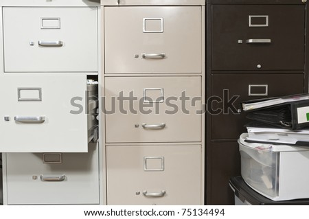 Funky file cabinets with binders boxes.