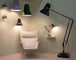 Funky lamps, hanging pendant lights, and white lounge chair interior design