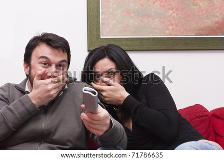 stock photo : Funny Adult Couple Watching Television. Save to a lightbox ▼