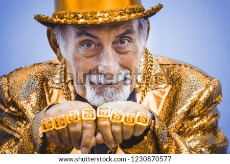 Funny and extravagant senior man posing on colored background - Youthful old man in the sixties having fun and partying #1230870577