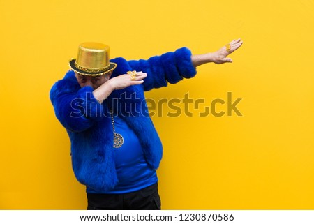 Funny and extravagant senior man posing on colored background - Youthful old man in the sixties having fun and partying #1230870586