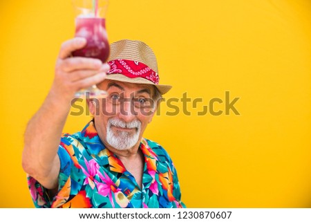 Funny and extravagant senior man posing on colored background - Youthful old man in the sixties having fun and partying #1230870607