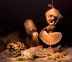 Funny artwork figurines dancing in an autumn decor