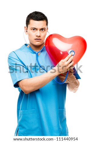 Funny asian doctor listening to heartbeat isolated on white background - stock photo