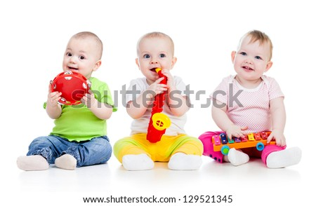 Funny babies girls group with musical toys isolated