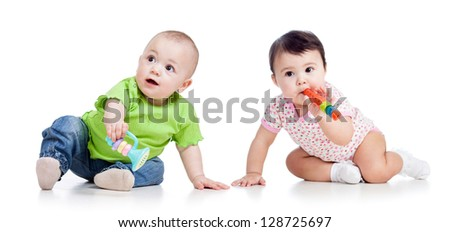 Funny babies girls  with musical toys isolated on white