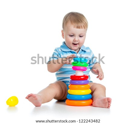 funny baby boy playing with colorful toy isolated on white