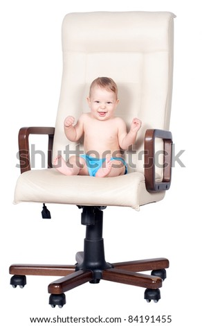 funny baby boy sits in office chair isolated on white background