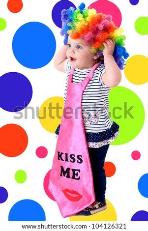 funny baby dressed as a clown with a colorful background
