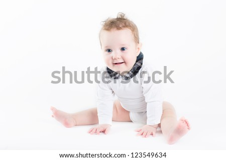 Funny baby girl sitting with a white background