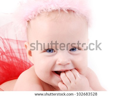 Funny baby girl with fingers into her mouth - stock photo