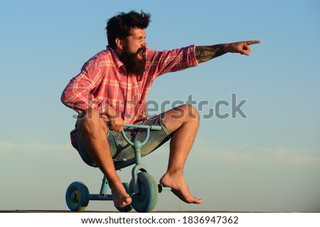 Funny bike. Old man acting like a kid Photo stock ©
