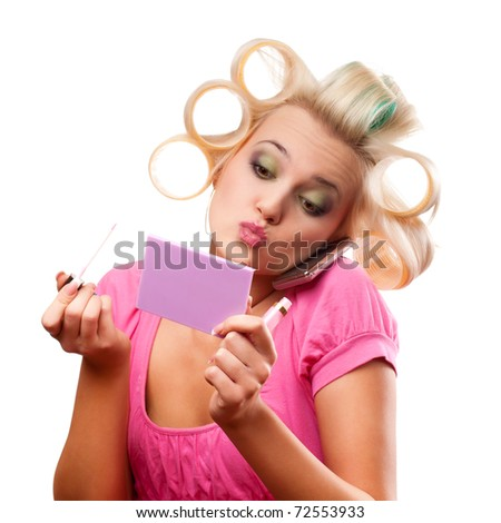 funny blonde woman with rollers on head over white