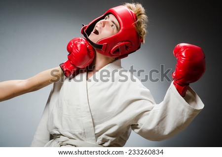 Funny boxer in sport concept