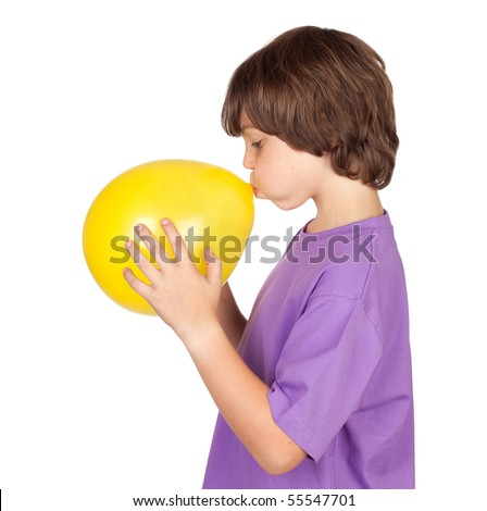 Funny boy blowing up a yellow balloon isolated on white background