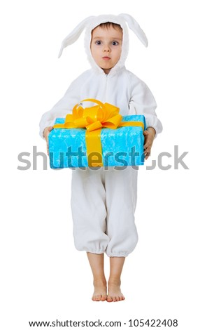 Funny boy dressed as a rabbit with a gift in the hands isolated on white background
