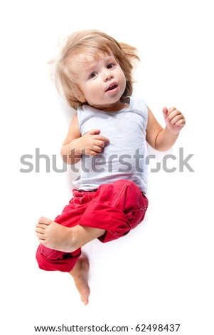 Funny boy in red pants, high angle view, isolated on white background