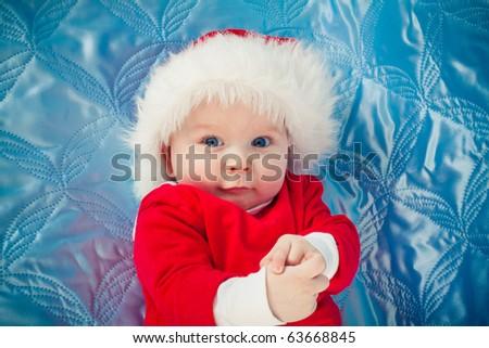 funny boy in santa claus costume