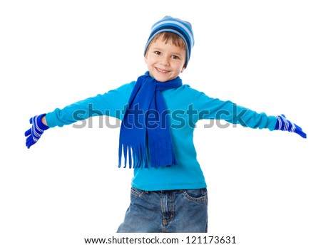 Funny boy in winter clothes with wide spread hands, isolated on white