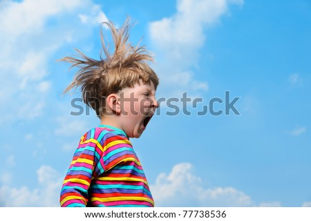 funny boy - jumping and screaming on the sky background