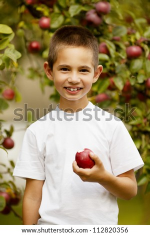 funny boy with apple
