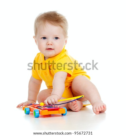 funny boy with musical toys