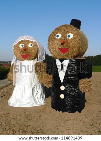 Funny bridal couple, consisted of hay bales