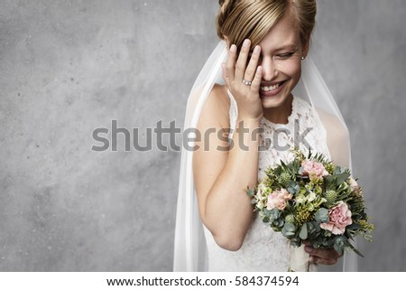 Funny bride laughing in studio #584374594